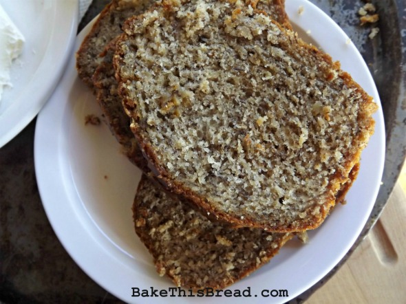 Sliced Vintage Banana Bread on a white dish BakeThisBread