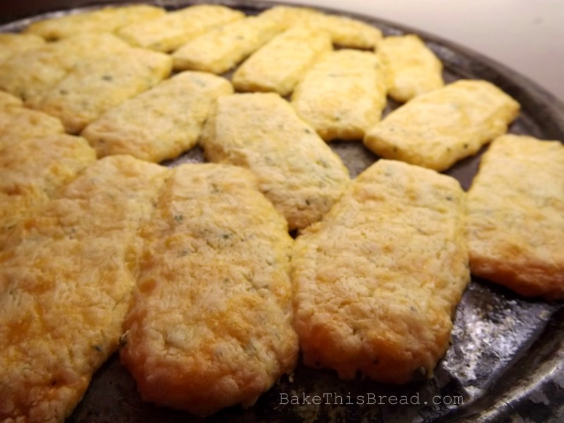 Homemade cheese puffs recipe baking on a pizza pan Bake This Bread