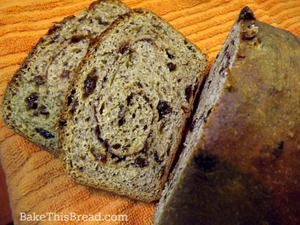 Slicing cinnamon swirl bread overhead by bake this bread