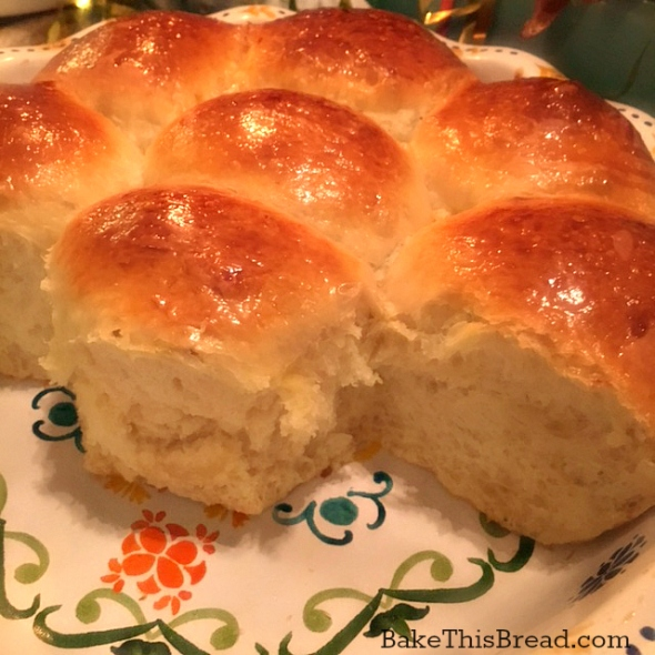 Yeasted homemade buttermilk rolls served from the ceramic baking dish by bake this bread